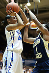 06 December 2012: Duke's Chloe Wells (4) shoots over Georgia Tech's Dawnn Maye (1). The Duke University Blue Devils played the Georgia Tech University Yellow Jackets at Cameron Indoor Stadium in Durham, North Carolina in an NCAA Division I Women's Basketball game. Duke won the game 85-52.