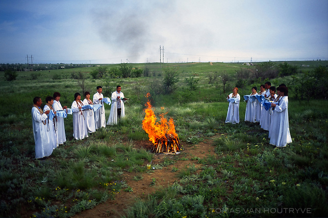 "Memebers of the ""Rebirth"" religious community participate in a ceremony in the middle of a field that they consider to have sacred magnetic powere on the outskirts of Elista, Republic of Kalmykia, Russian Federation on May 15, 2010. The unusual religious sect combines believes from multiple major religions as well as paranormal beliefs in extra-terrestrials, UFOs and cosmic powers. Among those that have participated in their ceremonies is Kalmyk president Kirsan Ilyumzhinov, who has stated on Russian national television that he believes he was abducted by aliens."