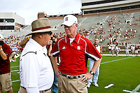 October 31, 2009:    Florida State head coach Bobby Bowden (L) talks with N. C. State head coach Tom O'Brien before the start of Atlantic Coast Conference action between the North Carolina State Wolfpack and Florida State Seminoles at Doak Campbell Stadium in Tallahassee, Florida.