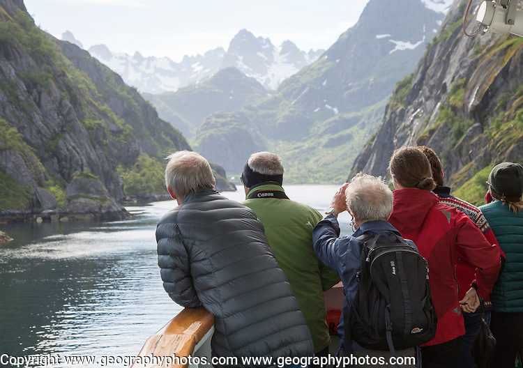 Tourists sightseeing from Hurtugruten ship, Trollfjorden, Lofoten Islands, Nordland, northern, Norway