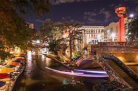 This is one of my favorite San Antonio images along the river walk  because it captured the cityscape at night of the river walk with the colorful umbrellas at Cafe Ole restaurant. Love the light trail created from the tour boats as they go under the pedestrian bridge with the city's Torch of Friendship on the street above. Watermark will not appear on image