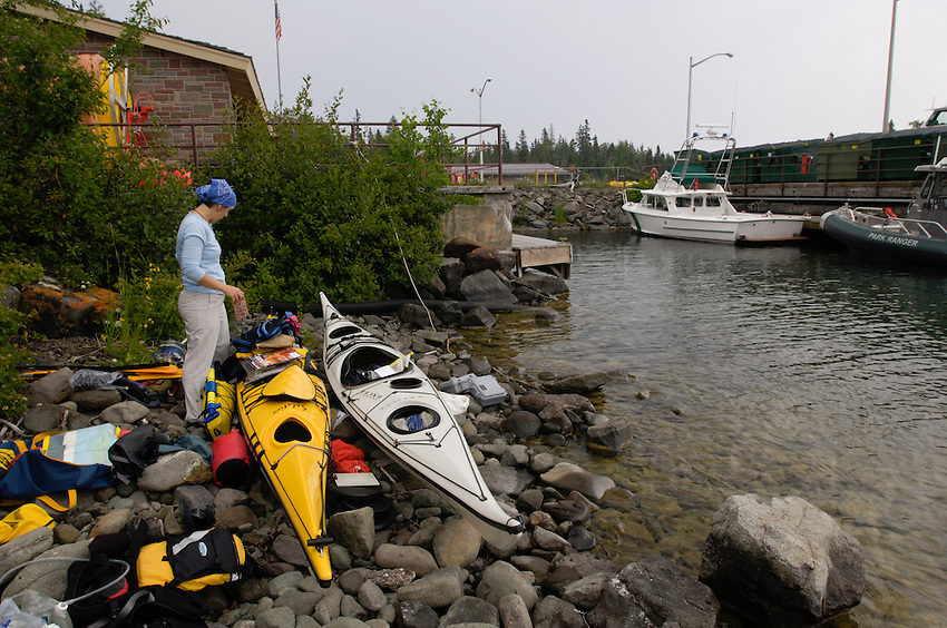 Sea kayakers prepare their gear while visiting Isle Royale National Park in Michigan.