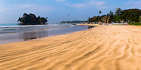 Panoramic photo of Weligama Beach and Taprobane Island, South Coast of Sri Lanka, Asia. This is a panoramic photo of Weligama Beach on the South Coast of Sri Lanka, Asia. Weligama Beach is one of a number of beautiful tropical beaches on the South Coast of Sri Lanka.