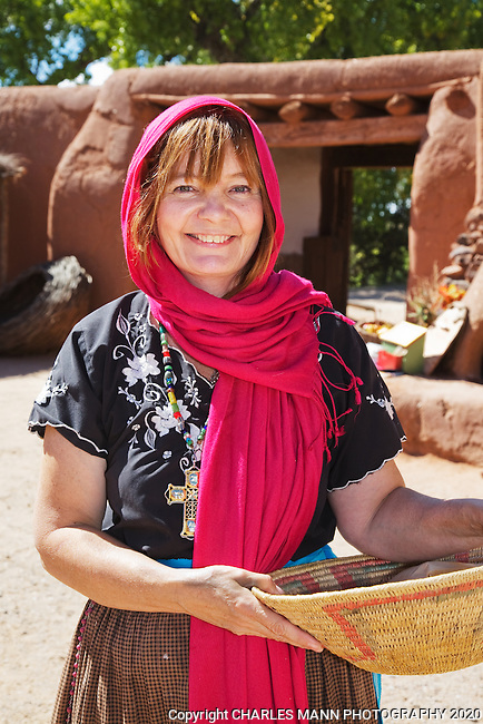 Volunteer Nancy Hart makes bread in a traditional outdoor oven called a horno at the Fall Festival at Rancho de Las Golondrinas, an historical museum near Santa Fe, New Mexico