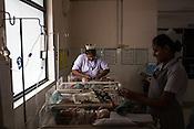 Nurses takes care of new born babies in the nursery of the Duncan Hospital in Raxaul, Bihar, India.