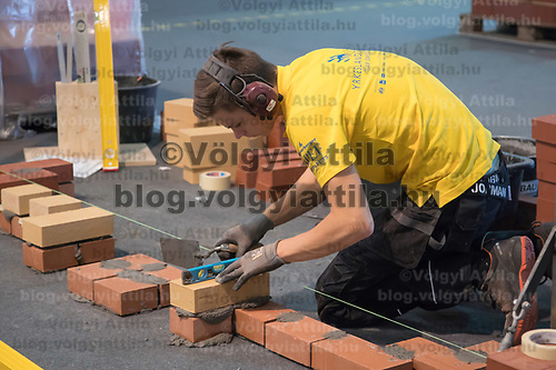 Participant competes in brick laying during the EuroSkills European Championship of young professionals in Budapest, Hungary on Sept. 26, 2018. ATTILA VOLGYI