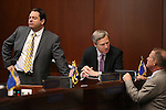 Nevada Senate Republicans Michael Roberson, left, and Greg Brower, center, and Lt. Gov. Mark Hutchison talk on the Senate floor at the Legislative Building in Carson City, Nev., on Wednesday, April 15, 2015.<br /> Photo by Cathleen Allison