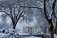 The White House blanketed in snow after a snowstorm on the morning of Feb. 3, 2010. (Official White House photo by Pete Souza)<br /> <br /> This official White House photograph is being made available only for publication by news organizations and/or for personal use printing by the subject(s) of the photograph. The photograph may not be manipulated in any way and may not be used in commercial or political materials, advertisements, emails, products, promotions that in any way suggests approval or endorsement of the President, the First Family, or the White House.
