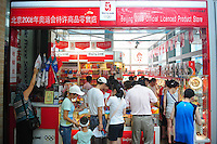 Aug. 6, 2008; Beijing, CHINA; Chinese fans shop at an Olympic merchandise store in Beijing. The Olympics begin at 8pm on August 8, 2008. Mandatory Credit: Mark J. Rebilas-