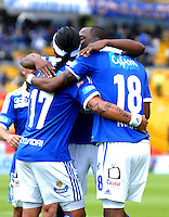 BOGOTA - COLOMBIA -03-11-2013: Jugadores de Millonarios celebran el gol anotado durante del partido por la fecha 17 de la Liga Postobon II-2013, jugado en el estadio Nemesio Camacho El Campin de la ciudad de Bogota. / The Players of Millonarios celebrate a goal during a match for the 17 date of the Postobon Leaguje II-2013 at the Nemesio Camacho El Campin Stadium in Bogota city, Photo: VizzorImage  / Luis Ramirez / Staff.