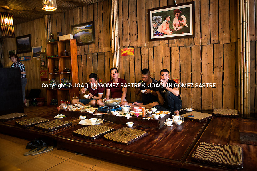 Some young people inside a typical food restaurant in Sa Pa is a border town and a district of L&agrave;o Cai province in northwestern Vietnam. It is one of the main market towns in the area, home to ethnic groups such as the Hmong<br /> SA PA - VIETNAM