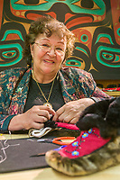 Native artist Margaret Gross-Hope sews traditional native moccasins made of seal skin at the Sitka National Historic Park in the coastal town of Sitka, Alaska