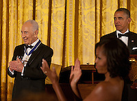 President Shimon Peres  of Israel (left) and first lady Michelle Obama applaud as United States President Barack Obama recognizes former President Bill Clinton (not shown) following the presentation to Peres of the Presidential Medal of Freedom during a dinner in his honor in the East Room of the White House in Washington, D.C. on Wednesday, June 13, 2012..Credit: Martin Simon / Pool via CNP /MediaPunch
