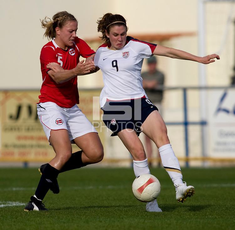 USWNT midfielder (9) Heather O'Reilly fights for the ball with Norwegian midfielder (5) Anneli Giske during the last group stage game in the Algarve Cup.  The USWNT defeated Norway, 1-0, in Ferreiras, Portugal. Photo by Brad Smith/ isiphotos.com