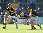 David Collins of Cratloe in action against Tony Kelly and Jack Browne of  Ballyea during the county senior hurling final at Cusack Park. Photograph by John Kelly.