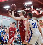 WOLCOTT, CT-031418JS13- Wamogo's Garrett Sattazahn (12) puts up a shot after getting past East Hampton's Sean Vick (31) during their Division V semifinal game Wednesday at Wolcott High School. <br /> Jim Shannon Republican-American