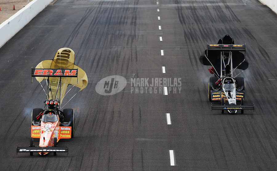 Feb. 21, 2010; Chandler, AZ, USA; NHRA top fuel dragster driver Cory McClenathan (left) defeats Troy Buff during the Arizona Nationals at Firebird International Raceway. Mandatory Credit: Mark J. Rebilas-