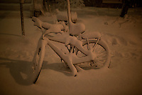 Snow covers a bike in Cambridge, Massachusetts, USA, as Winter Storm Nemo approaches on Friday, Feb. 8, 2013.