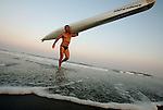 Warren Towns emerges from the surf with his ski on his shoulder after his second place finish in the Surfski Event at the First Annual Asbury Park Beach Bar Lifeguard Competition held at the 3rd Avenue beach in Asbury Park.  ASBURY PARK, NJ  8/4/07  8:21:47 PM  PHOTO BY ANDREW MILLS
