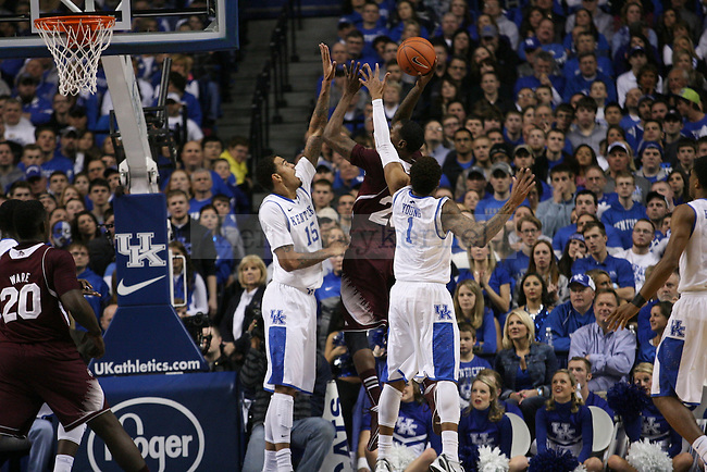 UK forward Willie Cauley-Stein and guard James Young block Miss State forward Roquez Johnson during the first half of the University of Kentucky men's basketball game vs. Mississippi State at Rupp Arena in Lexington, Ky., on Wednesday, January 8, 2014. Mississippi State leads Kentucky 40-37 at the half. Photo by Michael Reaves | Staff.