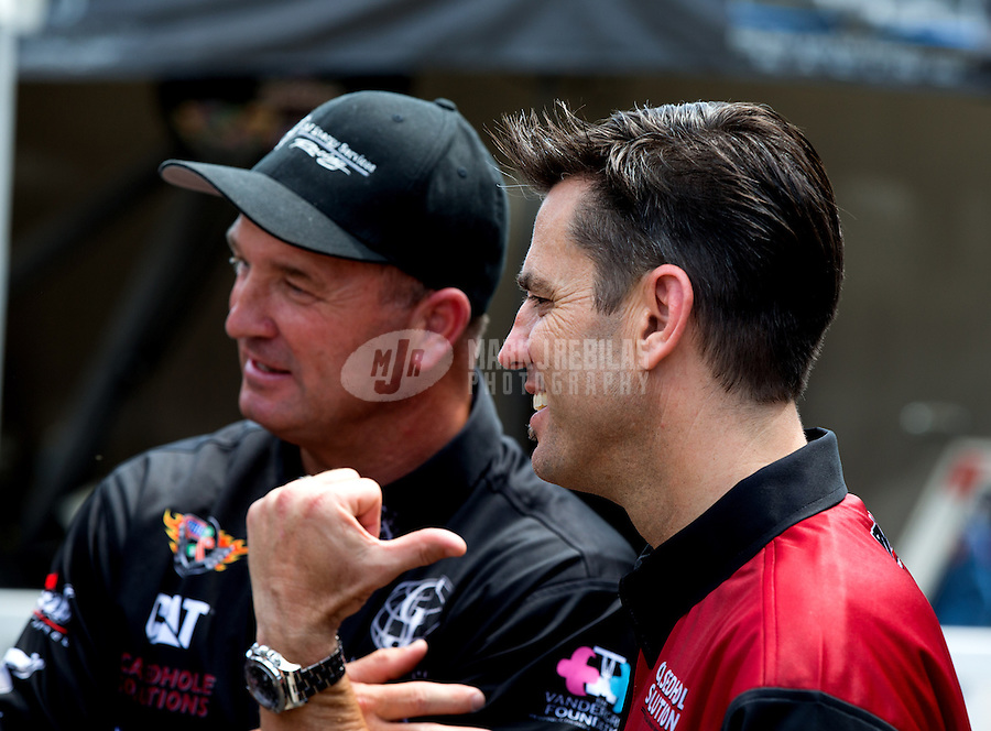 Apr 25, 2014; Baytown, TX, USA; NHRA top fuel driver Larry Dixon (right) and teammate Bob Vandergriff Jr during qualifying for the Spring Nationals at Royal Purple Raceway. Mandatory Credit: Mark J. Rebilas-USA TODAY Sports