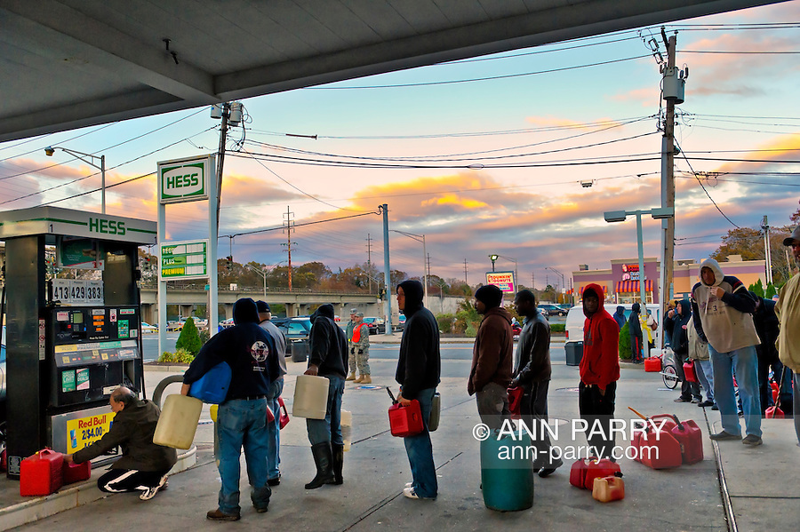 Nov. 3, 2012 - Merrick, New York, U.S. - People carrying gas containers wait on long lines at Hess, one of the Long Island gas stations open the Saturday after Hurricane Sandy battered this south shore area. U.S. Army National Guard members from Syracuse were at the station to help Nassau County police maintain order. The Freeport Armory in the next town was supposed to have free gas, up to 10 gallons for each car, this day, but people who showed up there were turned away. About 500,000 of the 1.2 million Long Islanders who lost power still didn't have it, and the area continued to suffer from severe damage from floods and wind.