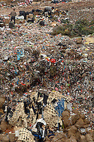 People scavenging at the landfill of Tangxia in Guangdong Province, China. As well as some domestic waste the landfill mostly comprises of waste, such as offcuts discarded from shoe and textile factories. Tangxia is a heavily polluted town..20 Mar 2007