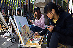 Art students are seen painting pictures of the old German protestant church in the old town of Qingdao.  The christian community has about 1200 members.