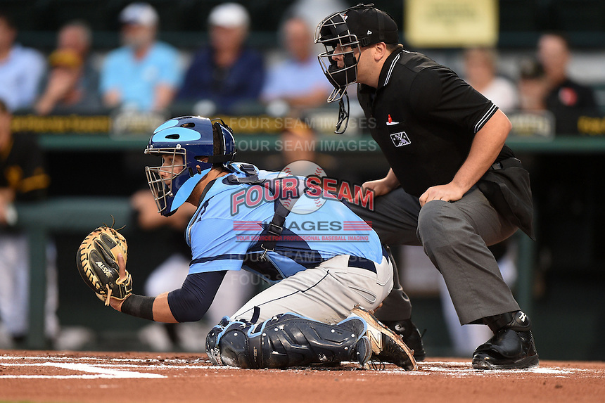 Charlotte Stone Crabs catcher Maxx Tissenbaum (8) and umpire Kirk Struble during a game against the Bradenton Marauders on April 20, 2015 at McKechnie Field in Bradenton, Florida.  Charlotte defeated Bradenton 6-2.  (Mike Janes/Four Seam Images)