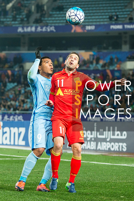 Jiangsu FC Forward Roger Beyker Martinez (L) fights for the ball with Adelaide United Forward Sergio Cirio (R) during the AFC Champions League 2017 Group H match between Jiangsu FC (CHN) vs Adelaide United (AUS) at the Nanjing Olympics Sports Center on 01 March 2017 in Nanjing, China. Photo by Marcio Rodrigo Machado / Power Sport Images
