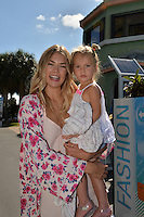 KEY BISCAYNE, FL - APRIL 03: (EXCLUSIVE COVERAGE) Sports Illustrated model Tori Praver-Fuller and daughter Ryan Fuller. Tori is an American model and swimwear Fashion designer perhaps best known for her appearances in the 2007-2009 Sports Illustrated Swimsuit Issue and as the Global Brand Ambassador for Billabong clothing in 2009 and for being the youngest, face of Guess clothing in 2006, at the age of 17. Seen here during day 12 of the Miami Open at Crandon Park Tennis Center on April 3, 2015 in Key Biscayne, Florida.<br /> <br /> <br /> People:  Tori Praver-Fuller, Ryan Fuller<br /> <br /> Transmission Ref:  FLXX<br /> <br /> Must call if interested<br /> Michael Storms<br /> Storms Media Group Inc.<br /> 305-632-3400 - Cell<br /> 305-513-5783 - Fax<br /> MikeStorm@aol.com