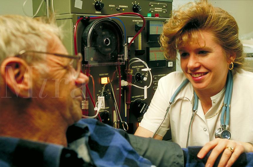 Nurse consoles dialysis patient.