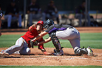Colorado Rockies Dom Nunez (5) tags Keinner Pina (8) sliding home during an Instructional League game against the Los Angeles Angels of Anaheim on October 6, 2016 at the Tempe Diablo Stadium Complex in Tempe, Arizona.  (Mike Janes/Four Seam Images)