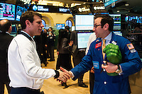 Former U.S. Men's National Team star Jeff Agoos shakes hands with Michael Pistillo Jr. of Barclays after ringing the closing bell of the NYSE during the centennial celebration of U. S. Soccer at the New York Stock Exchange in New York, NY, on April 02, 2013.