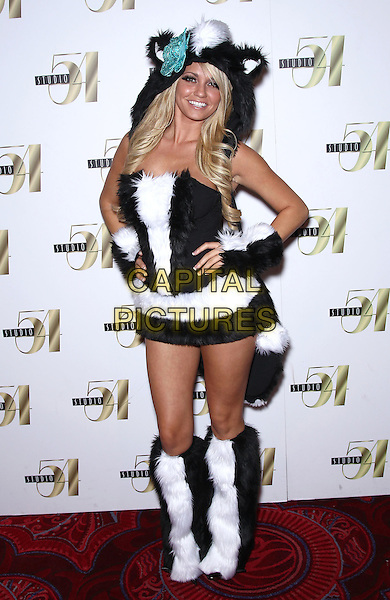 ANGEL PORRINO .Holly Madison hosts Hollyween at Studio 54 inside the MGM Grand Resort Hotel and Casino, Las Vegas, Nevada, USA, 30th October 2010..full length cat costume outfit black and white hood ears hands on hips knee high boots furry fur .CAP/ADM/MJT.© MJT/AdMedia/Capital Pictures.