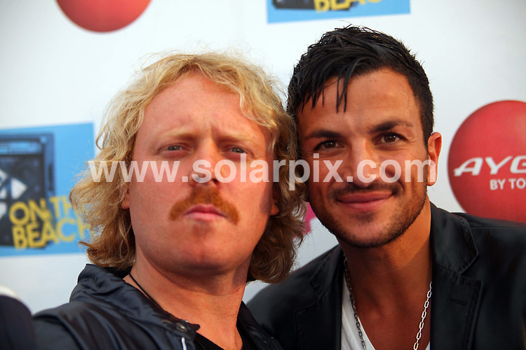 **ALL ROUND PICTURES FROM SOLARPIX.COM**.**WORLDWIDE SYNDICATION RIGHTS**.T4 on the Beach at Weston-super-Mare, UK. 19 July  2009..This pic: Avid Merrion and Peter Andre..JOB REF: 9538 NYA     DATE: 19_07_2009.**MUST CREDIT SOLARPIX.COM OR DOUBLE FEE WILL BE CHARGED**.**ONLINE USAGE FEE GBP 50.00 PER PICTURE - NOTIFICATION OF USAGE TO PHOTO @ SOLARPIX.COM**.**CALL SOLARPIX : +34 952 811 768 or LOW RATE FROM UK 0844 617 7637**