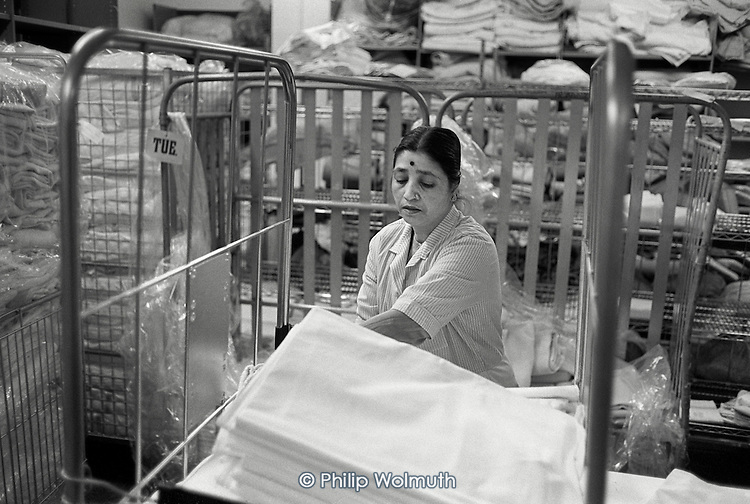 Ancillary worker in the laundry of St.Mary's Hospital, Praed Street, London.