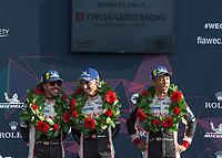 Sebastien Buemi (CHE), Fernando Alonso (ESP), Kazuki Nakajima (JPN) of TOYOTA GAZOO RACING (JPN) celebrate there win during the 2018 Silverstone - FIA World Endurance Championship at Silverstone Circuit, Towcester, England on 19 August 2018. Photo by Vince  Mignott.
