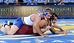 BROOKINGS, SD - NOVEMBER 17: Brady Ayers from South Dakota State gets riding time against Bobby Stevenson from the University of Minnesota during their 197 pound match Friday evening at First Arena in Brookings, SD.  (Photo by Dave Eggen/Inertia)