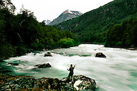 Fly fishing, seen in a long exposure, blurring rapids in the Futaleufu river in Patagonia, Chile