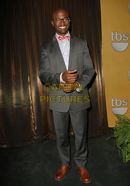Taye Diggs.19th Annual Screen Actors Guild Awards Nominations Announcement held at the Pacific Design Center, West Hollywood, California, USA..December 12th, 2012.SAG full length grey gray suit jacket red bow tie glasses.CAP/ADM/KB.©Kevan Brooks/AdMedia/Capital Pictures.