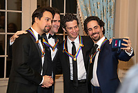 Hamilton co-creators Lin-manuel Miranda, Andy Blankenbuehler, Thomas Kail, and Alex Lacamoire, four of the recipients of the 41st Annual Kennedy Center Honors, pose for a selfie prior to sitting for a group photo following a dinner hosted by United States Deputy Secretary of State John J. Sullivan in their honor at the US Department of State in Washington, D.C. on Saturday, December 1, 2018.  The 2018 honorees are: singer and actress Cher; composer and pianist Philip Glass; Country music entertainer Reba McEntire; and jazz saxophonist and composer Wayne Shorter. This year, the co-creators of Hamilton, writer and actor Lin-Manuel Miranda; director Thomas Kail; choreographer Andy Blankenbuehler; and music director Alex Lacamoire will receive a unique Kennedy Center Honors as trailblazing creators of a transformative work that defies category.<br /> CAP/MPI/RS<br /> &copy;RS/MPI/Capital Pictures