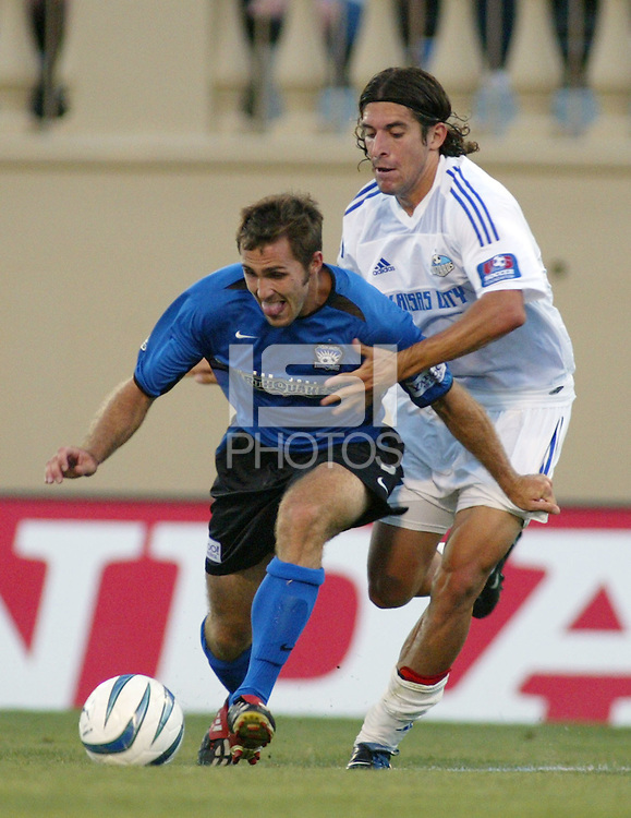 Earthquakes Midfielder Brian Mullan dribbles the ball away from Wizards Defender Nick Garcia at San Jose Spartan Stadium in San Jose, California on June 28th, 2003.  Earthquakes ties Wizards in 0-0 in overtime.