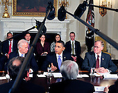 Washington, D.C. - January 4, 2010 -- United States President Barack Obama and Vice President Joseph Biden meet with a bipartisan group of Governors from across the country in the State Dining Room to discuss energy policy in Washington, D.C. on Wednesday, February 3, 2010.  From left to right: Vice President Biden; President Obama; Governor Jim Douglas (Republican of Vermont), Chairman, National Governors Association (NGA)..Credit: Ron Sachs / Pool via CNP