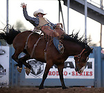 Ty Breuer competes in the saddle bronc event at the Reno Rodeo in Reno, Nev., on Thursday, June 27, 2013.<br /> Photo by Cathleen Allison
