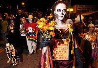 Jessica Pushor walks in the All Souls' Procession on North Fourth Avenue Sunday night. Pushor was walking for her grandfather, Bill Schrader, who passed away last month. About 3000 people took park in the procession.