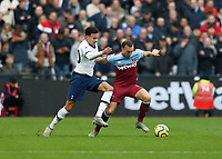 23rd November 2019; London Stadium, London, England; English Premier League Football, West Ham United versus Tottenham Hotspur; Dele Alli of Tottenham Hotspur challenges Mark Noble of West Ham United - Strictly Editorial Use Only. No use with unauthorized audio, video, data, fixture lists, club/league logos or 'live' services. Online in-match use limited to 120 images, no video emulation. No use in betting, games or single club/league/player publications