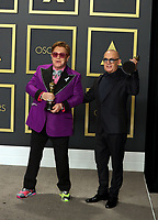 09 February 2020 - Hollywood, California -    Bernie Taupin, Elton John attend the 92nd Annual Academy Awards presented by the Academy of Motion Picture Arts and Sciences held at Hollywood & Highland Center. Photo Credit: Theresa Shirriff/AdMedia