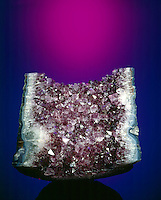AMETHYST CRYSTALS (SiO2) IN GEODE<br /> Crystallized Silica Group<br /> Hexagonal-Trigonal trapezohedral<br /> A variety of quartz with violet to purple color, which is caused by the presence of compounds of iron or manganese. Hardness 7; glassy luster.