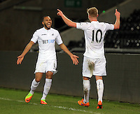 Pictured: Adam King of Swansea (R) celebrates one of his hat trick goals with Kenji Gorre Tuesday 28 February 2017<br /> Re: Premier League International Cup, Swansea City U23 v Hertha Berlin II at at the Liberty Stadium, Swansea, UK